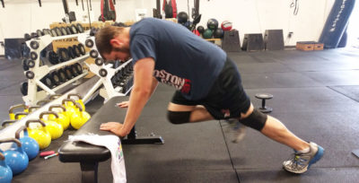 The mountain climber, shown here at an incline, is an easy way to elevate heart rate while working the chest and core.